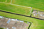Nederland, Noord-Holland, Zaanstad, 20-04-2015; volkstuintjes in de Noordpolder, behorende bij de nieuwe woonwijk Saendelft, tussen Assendelft en Krommenie<br /> Allotment gardens in polder near Assendelft.<br /> Newly developed residential area, Zaanstad. <br /> luchtfoto (toeslag op standard tarieven);<br /> aerial photo (additional fee required);<br /> copyright foto/photo Siebe Swart