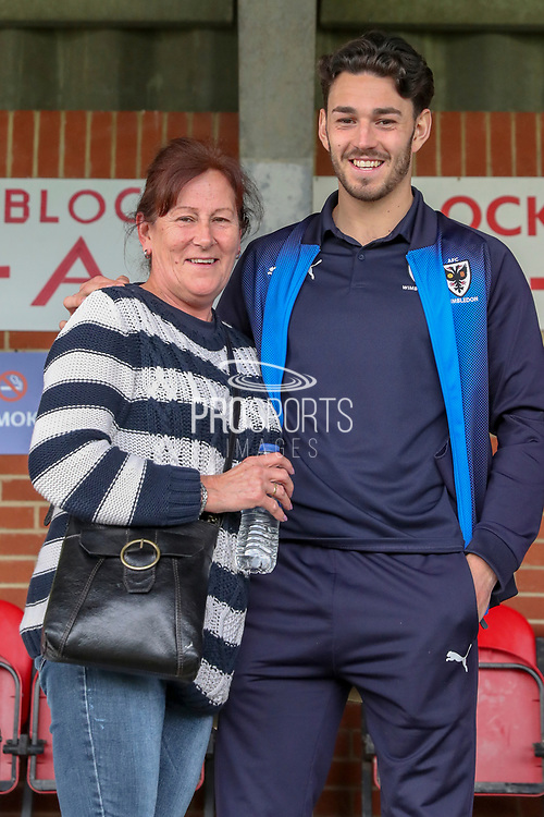AFC Wimbledon defender Will Nightingale (5) posing with fan during the EFL Sky Bet League 1 match between AFC Wimbledon and Gillingham at the Cherry Red Records Stadium, Kingston, England on 23 March 2019.