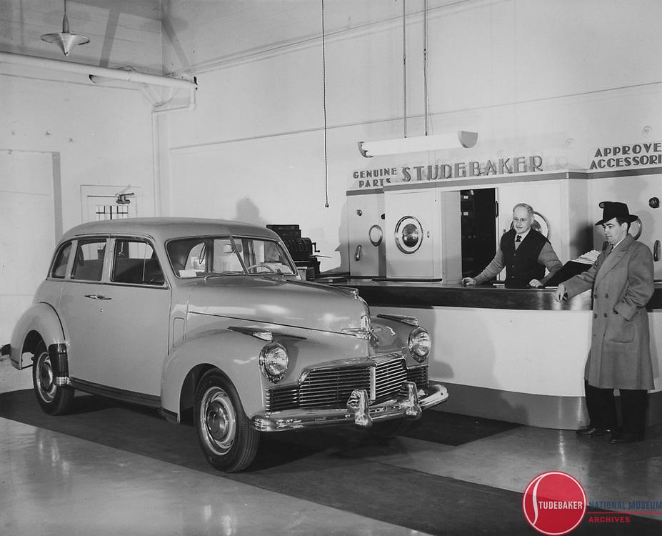 1946 Studebaker Skyway Champion in a Studebaker dealer's parts department.