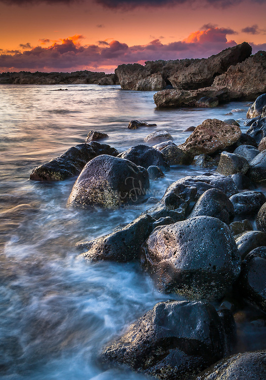 Volcanic boulders on beach on the northern shoreline of Oahu, Hawaii
