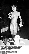 Stephanie Romana reporting for Saturday Night Live on the Terrace of Chateau Marmont during a party given by the Ford Models Agency.  Los Angeles. March 1995. Film 95538/34<br />© Copyright Photograph by Dafydd Jones<br />66 Stockwell Park Rd. London SW9 0DA<br />Tel 0171 733 0108