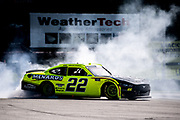 Henry 180, Road America in Elkhart Lake, Wisconsin. Austin Cindric, Team Penske, Ford does a burnout after winning the Henry 180