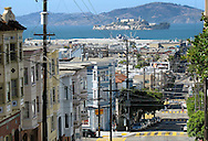 The streets of San Francisco offer a view of Alcatraz Island, a small island located San Francisco Bay. It has  served as a lighthouse, a military fort, a military prison and a federal prison..Today, the island is a historic site as part of the Golden Gate National Recreation Area.