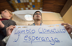"""1 December 2019, Madrid, Spain: """"Cambio Climático y Esperanza"""" (Climate Change and Hope') reads the text, as Lutheran World Federation delegate Sebastian Ignacio Muñoz Oyarzo from the Evangelical Lutheran Church in Chile holds a sheet of paper on which key discussion points have been summarized, as representatives of various faiths gather in the Iglesia de Jesús (Church of Christ) of the Iglesia Evangélica Española (Evangelical Church of Spain) for an interfaith dialogue and prayer service on the eve of the United Nations climate conference (COP25) in Madrid, Spain."""