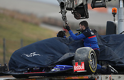 Toro Rosso's Alexander Albon's car is lifted onto a truck after spinning on his opening lap during day two of pre-season testing at the Circuit de Barcelona-Catalunya.