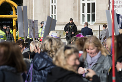 © Licensed to London News Pictures  . 03/10/2017 . Manchester , UK . An armed policeman stands guard outside Manchester Central Library , as WASPI protesters demonstrate outside the conference , on day three of the Conservative Party Conference at the Manchester Central Convention Centre . Photo credit : Joel Goodman/LNP