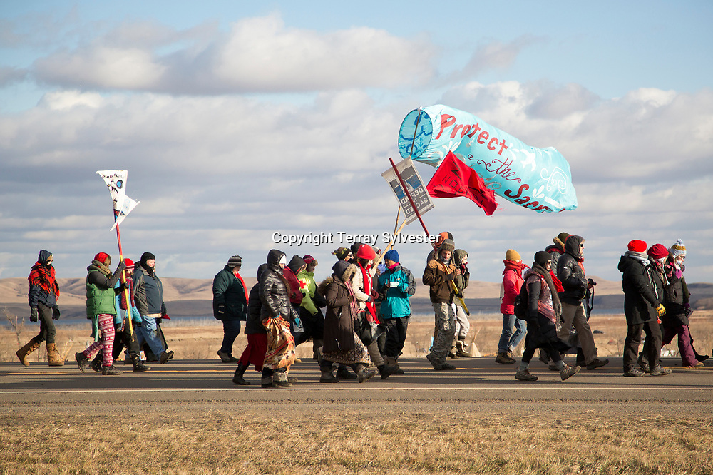 Opponents of the Dakota Access oil pipeline walk back to their camp after a demonstration near the pipeline route on November 18, 2016. Cannon Ball, North Dakota, United States.
