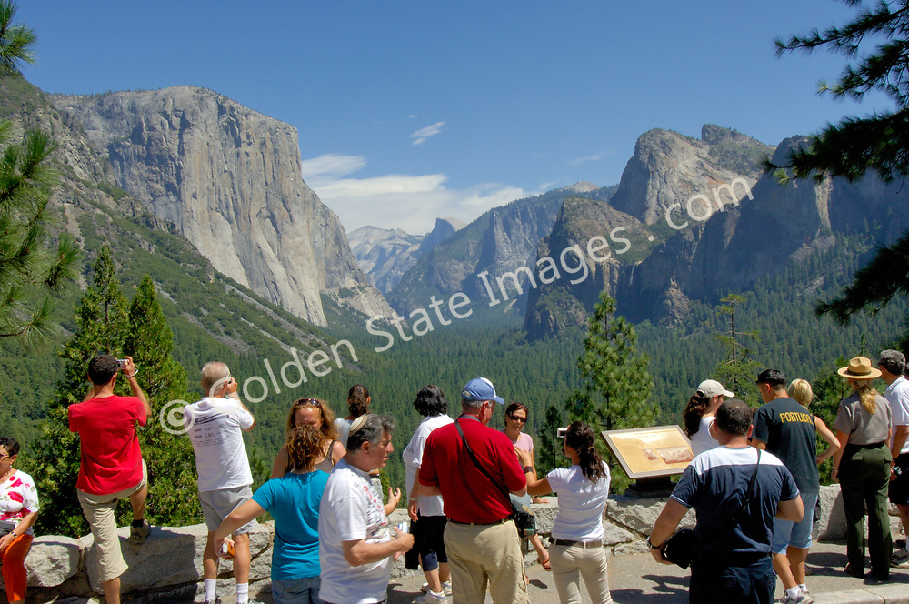 Another group of park visitors take in the view of the valley. <br /> <br /> Over four million people visit Yosemite each year.