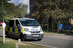 © Licensed to London News Pictures. 30/09/2016. Oxford, UK. A police van sits outside a school on the Marston Ferry Road in the Summertown area of Oxford. A police hunt continues in Oxford for two men who abducted and raped a 14-year-old girl while she was on her way to school. The teenager was snatched and driven away from the Summertown area of Oxford at 8.25 on Wednesday morning. Photo credit: Peter Macdiarmid/LNP