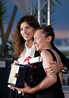 Actress Emmanuelle Bercot, winner of the Best Actress Prize for Mon Roi with director Maiwenn at the Palm D'Or award winners photo call at the 68th Cannes Film Festival Sunday May 24th 2015, Cannes, France.