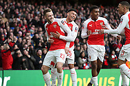 Calum Chambers of Arsenal celebrates scoring his sides 1st goal with Alex Oxlade-Chamberlain of Arsenal. The Emirates FA cup, 4th round match, Arsenal v Burnley at the Emirates Stadium in London on Saturday 30th January 2016.<br /> pic by John Patrick Fletcher, Andrew Orchard sports photography.