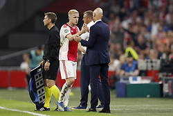 (L-R) Donny van de Beek of Ajax, Ajax coach Erik ten Hag during the UEFA Champions League play offs round first leg match between Ajax Amsterdam and Dynamo Kyiv at the Johan Cruijff Arena on August 22, 2018 in Amsterdam, The Netherlands