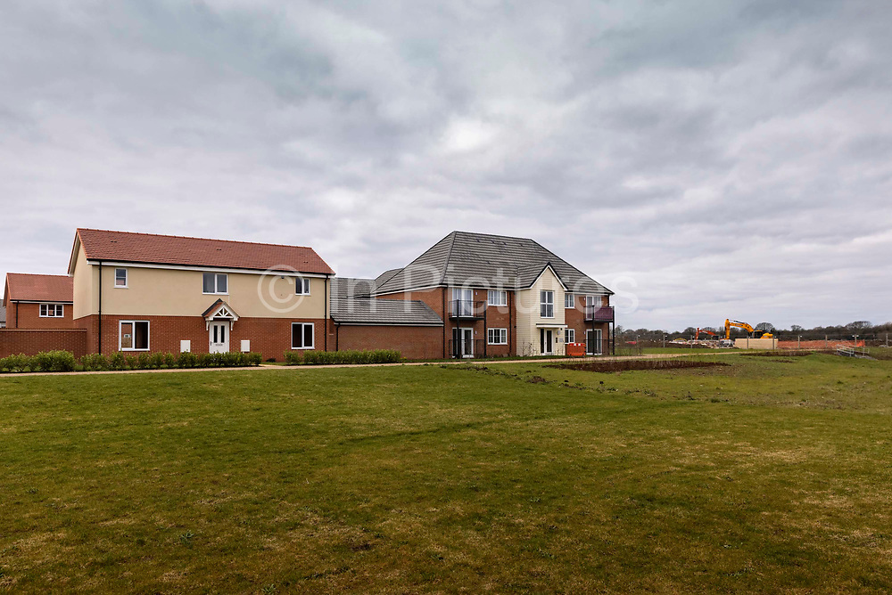 A new build housing estate on 7th March, 2021 in Maldon, Essex, United Kingdom. To comply with national guidelines and meet local demand,  Essex needs to build 0ver 140,000 new homes per year to 2036. The Districts unique heritage and countryside will be protected by maintaining high density design standards and adhering to the principles of sustainable development.