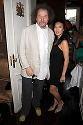 MIKE FIGGIS and pianist ROSEY CHAN at a party hosted by the Supper Club in honour of Mary Greenwell held at Beach Blanket Babylon, Ledbury Road, London on 25th June 2008.<br /><br />NON EXCLUSIVE - WORLD RIGHTS
