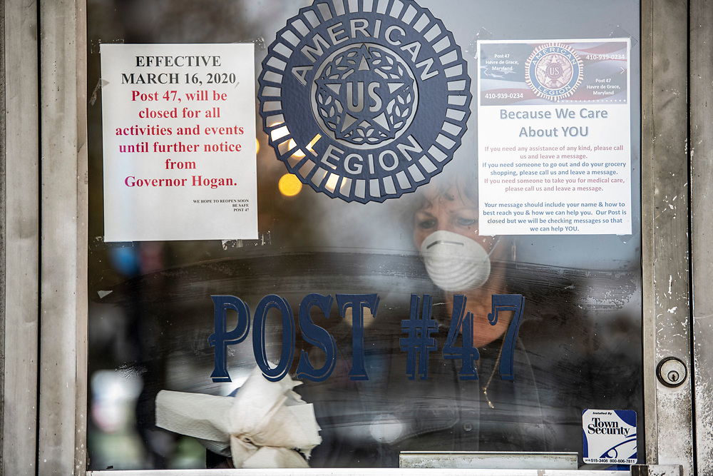 """As part of the COVID-19 response, Shirley Gittings, Post Manager of Joseph L. Davis American Legion Post 47 in Havre de Grace, Md., helps keep the post clean and maintains a """"drive up style"""" food pantry to help their community during the outbreak on Thursday, April 23.  Photo by Matt Roth/The American Legion"""
