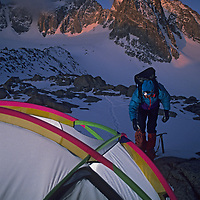 A mountaineer leaves camp for a climb up one of the 14,000-foot peaks above the nearby Palisade Glacier in California's Sierra Nevada.