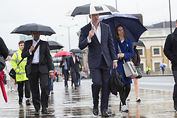 © Licensed to London News Pictures. 31/05/2016. LONDON, UK.  Commuters walk from London Bridge station during heavy rain and windy weather this morning.  Photo credit: Vickie Flores/LNP