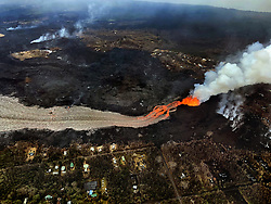 June 10, 2018 - Pahoa, Hawaii, U.S - The Kilauea Volcano east rift zone eruption continues as seen from the air mainly from Fissure 8 and forms a river of lava flowing down from Leilani Estates to Kapoho on Sunday. (Credit Image: © L.E. Baskow via ZUMA Wire)