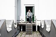 Rocco Ali, un dipendente MIvar, sul tetto della nuova fabbrica, vuota e mai utilizzata, Abbiategrasso 18 marzo 2014. Guido Montani / OneShot