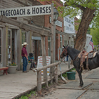 A wrangler and his son wait to offer rides to tourists in Virginia City, a ghost town that was once the capital of Montana Territory.