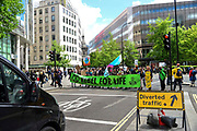 Climate change activists from the Extinction Rebellion group stand in the blocking traffic close to St Pauls tube station demanding that the British Government acknowledge the climate crisis posed by global warming on 25th April 2019 in London, England, United Kingdom.