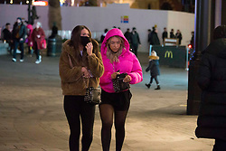 © Licensed to London News Pictures.05/12/2020. London, UK. Londoners are seen making the most of the first Saturday night out in Leicester Square, central London as second national lockdown has ended. Photo credit: Marcin Nowak/LNP