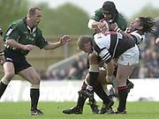 Sport - Rugby 27/04/2002 Parker Pen Shield - Semi-Final<br />London Irish vs Pontypridd - Kassam Stadium - Oxford<br />[L] Brenan VENTER,  Chris Sheasby is tackled by Richard Parks and Jon Bryant