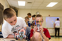 "Cameron and Alden add a lift to their Lego robotic droid during ""Let Go Your Mind"" summer camp through Gilford Parks and Recreation at the Gilford Middle School on Wednesday.  (Karen Bobotas/for the Laconia Daily Sun)"