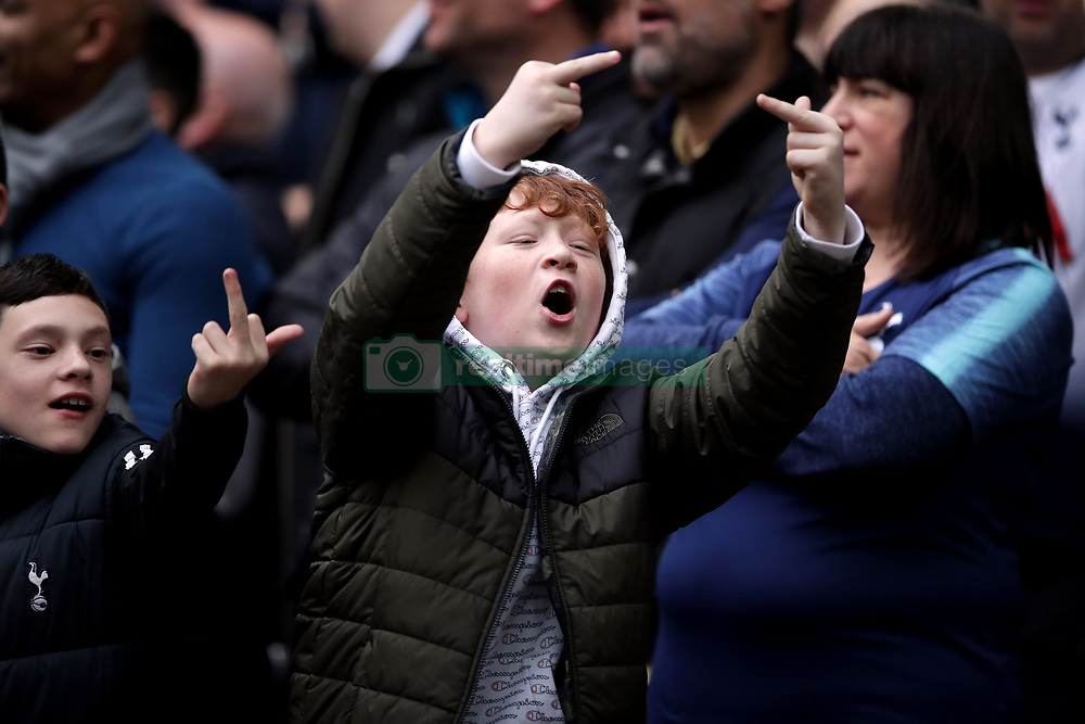*Editors note content* A young Tottenham Hotspur fan gestures in the crowd during the Premier League match at Wembley Stadium, London.