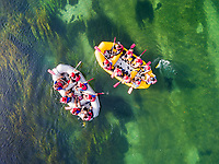UNA RIVER, BOSNIA - SEPTEMBER 2016: Aerial view of people in two raft boats on Una river, Bosnia and Herzegovina.