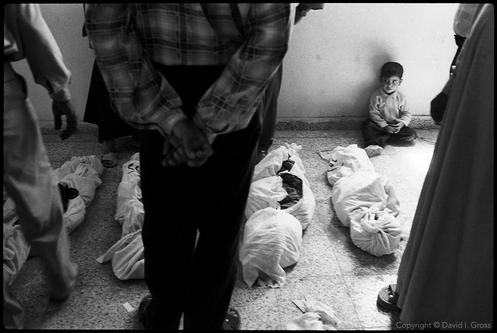 While the adults moved from shroud to shroud, trying to find their dead relatives, children waited or played among the dead that covered the floor of the gymnasium in the Iraqi city of Al-Musayib. Although they seemed unmoved by the bodies around them, a psychologist said the children often have terrible nightmares.
