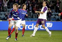 Fotball<br /> UEFA cup<br /> 1. runde<br /> 04.10.07<br /> Ullevaal stadion<br /> Vålerenga VIF - Austria Wien<br /> Freddy dos Santos jubler for sin 1-1 scoring men til liten nytte - venstre Christian Grindheim - høyre Milenko Acimovic<br /> Foto - Kasper Wikestad
