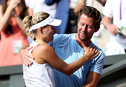 Angelique Kerber celebrates her win with her coach Wim Fissette on day twelve of the Wimbledon Championships at the All England Lawn Tennis and Croquet Club, Wimbledon.
