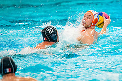 Jesse Koopman of the Netherlands in action against Enzo Khasz of France during the Olympic qualifying tournament. The Dutch water polo players are on the hunt for a starting ticket for the Olympic Games on February 17, 2021 in Rotterdam