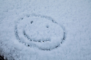 Smiley face during heavy snow fall in Birmingham, United Kingdom. Deep snow arrived in much of the UK, closing roads and making driving treacherous, while many people simply enjoyed the weather.