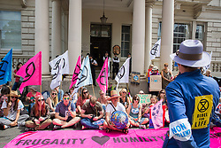 London, UK. 5 July, 2019.  Climate activists from Extinction Rebellion protest outside the French embassy in solidarity with members of Extinction Rebellion France who were pepper-sprayed at short range by French police after they occupied the Pont de Sully in central Paris to call for more government action and media attention on climate change.