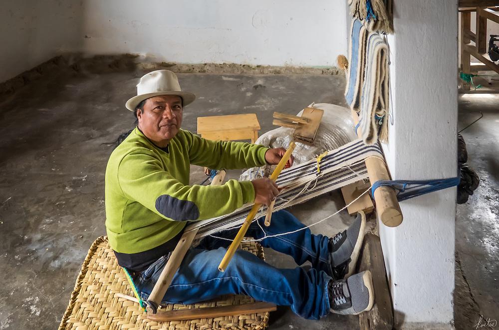 A Kichwa Weaver with a scarf loom in his native village of La Calera