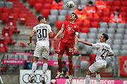 Thomas Müller Mueller #25 von FC Bayern Muenchen, #30 Christian Guenter von SC Freiburg, #27 Nicolas Hoefler von SC Freiburg During the Bayern Munich vs SC Freiburg Bundesliga match  at Allianz Arena, Munich, Germany on 20 June 2020.