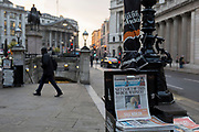 Outside the Bank of England in the City of London, copies of the London Evening Standard newspaper with the headline about Brexit 'Get us out of this No Deal Madness', on 24th January 2019, in London, England.