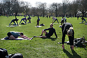 Daily life continues but not as as normal with some rules and restrictions in Hackney on 21st March 2020 in London, United Kingdom. As leisure centres are closed, people exercise on London Fields.