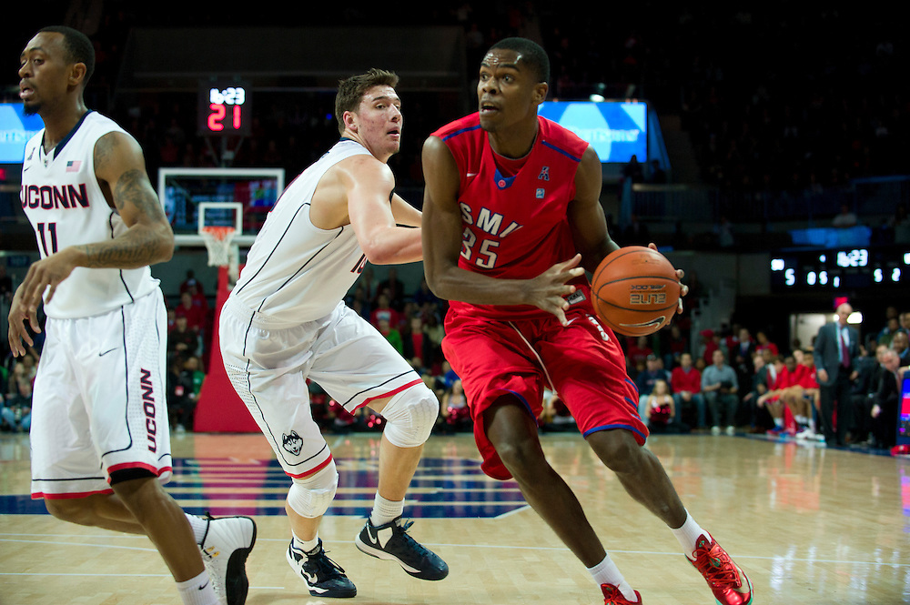 DALLAS, TX - JANUARY 4: Yanick Moreira #35 of the SMU Mustangs drives to the basket against the Connecticut Huskies on January 4, 2014 at Moody Coliseum in Dallas, Texas.  (Photo by Cooper Neill/Getty Images) *** Local Caption *** Yanick Moreira