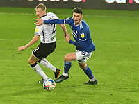 Football - 2020 / 2021 Sky Bet Championship - Swansea City vs Cardiff City - Liberty Stadium<br /> <br /> Kieffer Moore Cardiff City on the attack Ryan Bennett Swansea City defends in the South Wales local derby match<br /> <br /> COLORSPORT/WINSTON BYNORTH