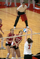 09 OCT 2005 Redbird Kari Staehlin hammers one over the net only to have it rejected by Brave Briony Hammet. The Illinois State University Redbirds hosted arch rival Bradley University Braves.  The Redbirds soared over the Braves, taking the match in 4 games, losing only game number 2.  Action included play by Braves Star Lindsey Stalzer who is ranked no. 7 in the nation in kills per game.  The first defeat of the conference season for the Braves took place at Redbird Arena on Illinois State's campus in Normal IL.