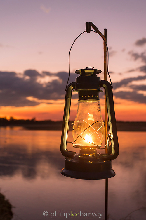 Lantern at sunset by Luangwa River in South Luangwa National Park, Zambia