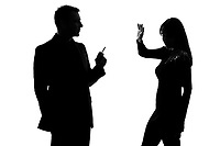 one caucasian couple man smoking cigarette and woman disturbed in studio silhouette isolated on white background