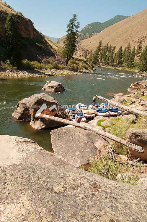 Climbing on boulders at Aparajo, Middle Fork of the Salmon River, Idaho.