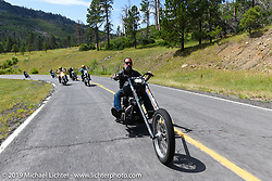 Chopper Charlie Weisel riding out to a reservoir during the Run to Raton. Raton, NM. USA. Saturday July 21, 2018. Photography ©2018 Michael Lichter.