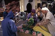 A street vendor sells radishes inside the medinah of the ancient city of Fes el Bali