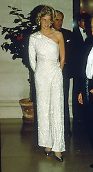 Diana, Princess of Wales, wearing an off the shoulder gown by Japanese designer Hachi, attends a gala dinner at the National Gallery in Washington DC on November 11, 1985