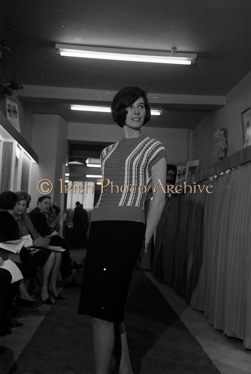 09/04/1964<br /> 04/09/1964<br /> 09 April 1964<br /> Fashion show at Woolcraft Fashion Week at Creation Arcade, Grafton Street, Dublin. Woolcraft Ltd showcase of Alpine Knitwear and Carina Jerseywear. Model wearing design. Model Ann Carolan nee Kavanagh originally from Spalodge, Phoenix Park, Dublin